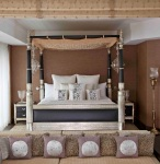 Four Poster Bed Flanked by Crystal Chandeliers