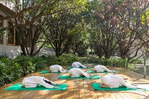 Open-air yoga at Vana, Malsi Estate
