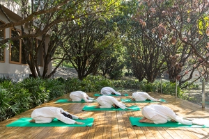 Open-air yoga at Vana, Malsi Estate