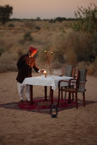 Enjoy a candlelit meal under the stars whilst listening to the songs of the desert