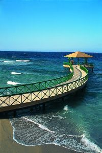 The pier at The Oberoi, Sahl Hasheesh stretches into the Red Sea, home to an abundance of marine life