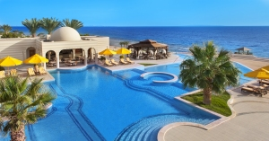 The swimming pool at The Oberoi, Sahl Hasheesh neighbours the  beachfront