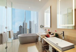 A guest bathroom with stunning city views at The Oberoi, Dubai